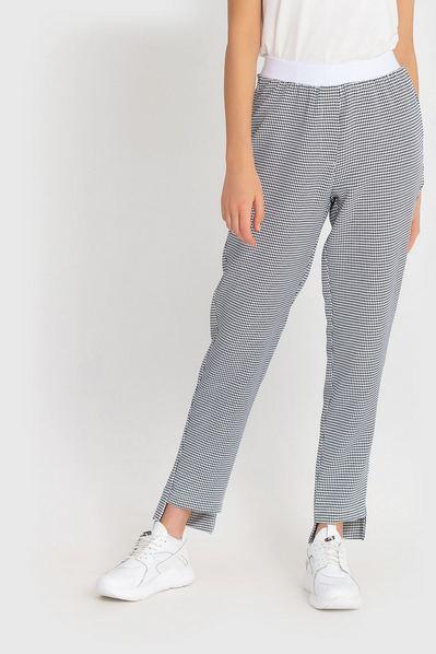 Женские брюки с асимметричным низом принт гусиная лапка