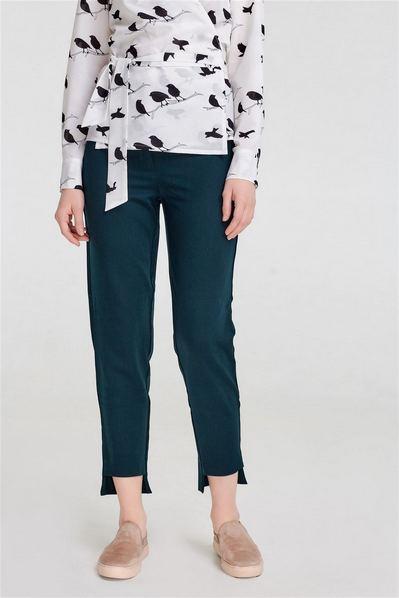 Женские брюки с асимметричным низом изумрудные