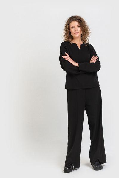 Расклешенные черные брюки с начесом